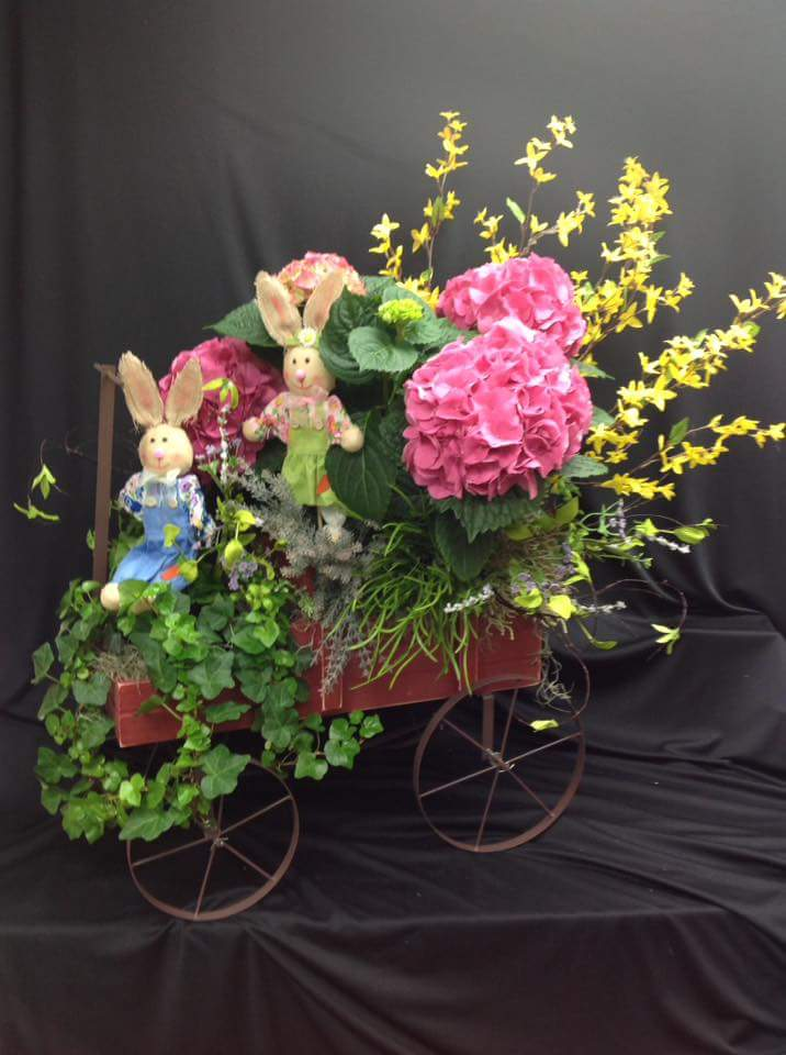Bunnies On A Cart With Flowers